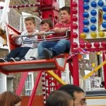 An image showing kids having fun on the big wheel